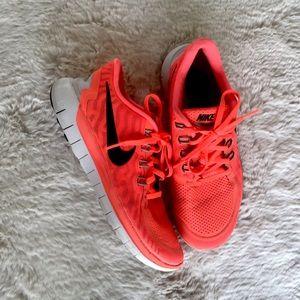 Nike Free 5.0 orange running sneakers
